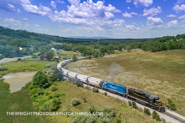 """Two GP38 models lead the eastbound Winchester and Western """"Sandman"""" run from Gore, VA to Winchester and is seen here climbing the grade of Gainsboro Hill as it approaches the summit on the hot and humid afternoon of July 2, 2020."""