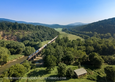 The head end of a South Branch Valley Railroad southbound makes the days first crossing of the South Branch of the Potomac River just south of Springfield, WV on Monday, August 10, 2020