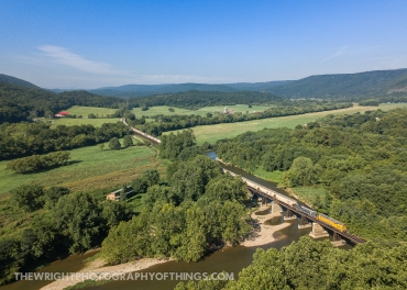 The heritage duo pushes 44 cars on a South Branch Valley Railroad southbound across the South Branch of the Potomac River south of Springfield, WV August 10, 2020