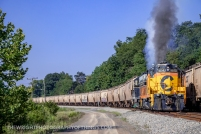 The train begins its upgrade assault out of Green Spring, WV. The days helper engines include SBVR 6240 and 6604 wearing the South Branch Valley's predecessor paint schemes.