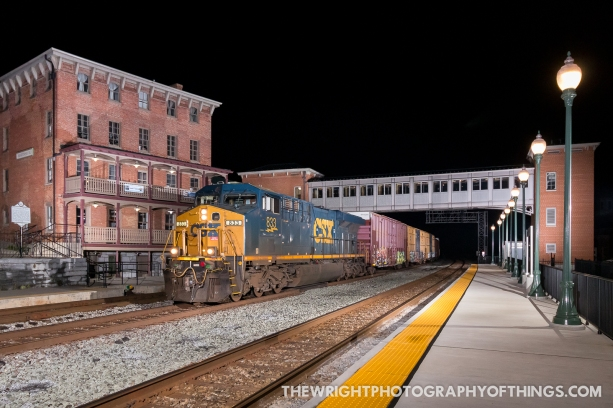 """Q372 with a single leader rushes by the Martinsburg, WV Station and Roundhouse Complex on Saturday, Sept 26, 2020. The platform on the east side of track one was just completed and this was a bucket list shot of mine when it was first announced a few years ago. Berkeley Hotel, the brick structure on the left dates to the railroad's arrival in 1842 & saw witness to the destruction of the the adjacent roundhouses by Stonewall Jackson in 1862. The B&O bought the building in 1866, expanded it, and used it as the station, eating house, telegraph office, and hotel. In 1877 the trainmen and enginemen here struck to protest wage cuts, starting the """"Great Strike of 1877"""" nationwide. Railroad and military officials suppressed the strike here, using this building as headquarters."""